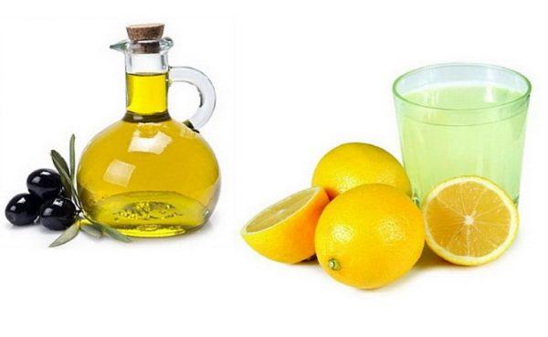 Оливковое масло, лимоны, стакан воды с лимонным маслом