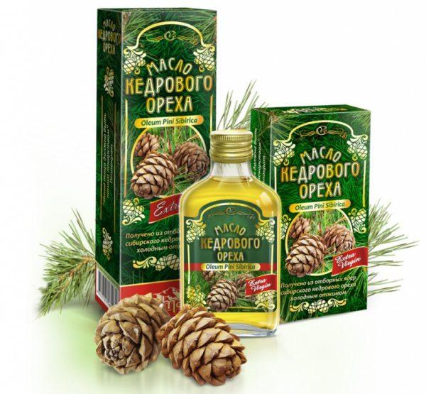 Масло кедрового ореха в стеклянной бутылке и картонной пачке, рядом лежат кедровые шишки